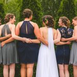 bride and bridesmaids facing back to show hair