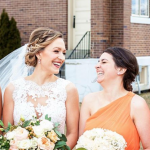 laughing bride and bridesmaid